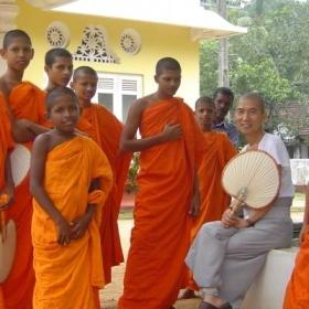 Young monks stand together near Sri Lanka volunteering opportunities with Projects Abroad.